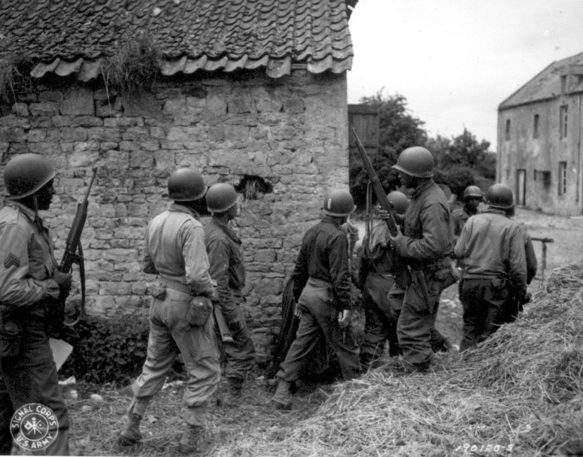 A group of support troops go hunting for a sniper, June 10, 1944, Vierville-sur-Mer, France (near Omaha Beach)