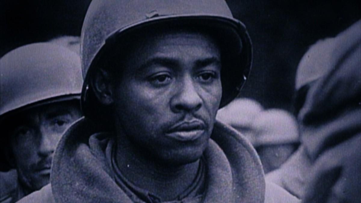 German newsreel still of George Schomo (Newark, NJ) after capture.