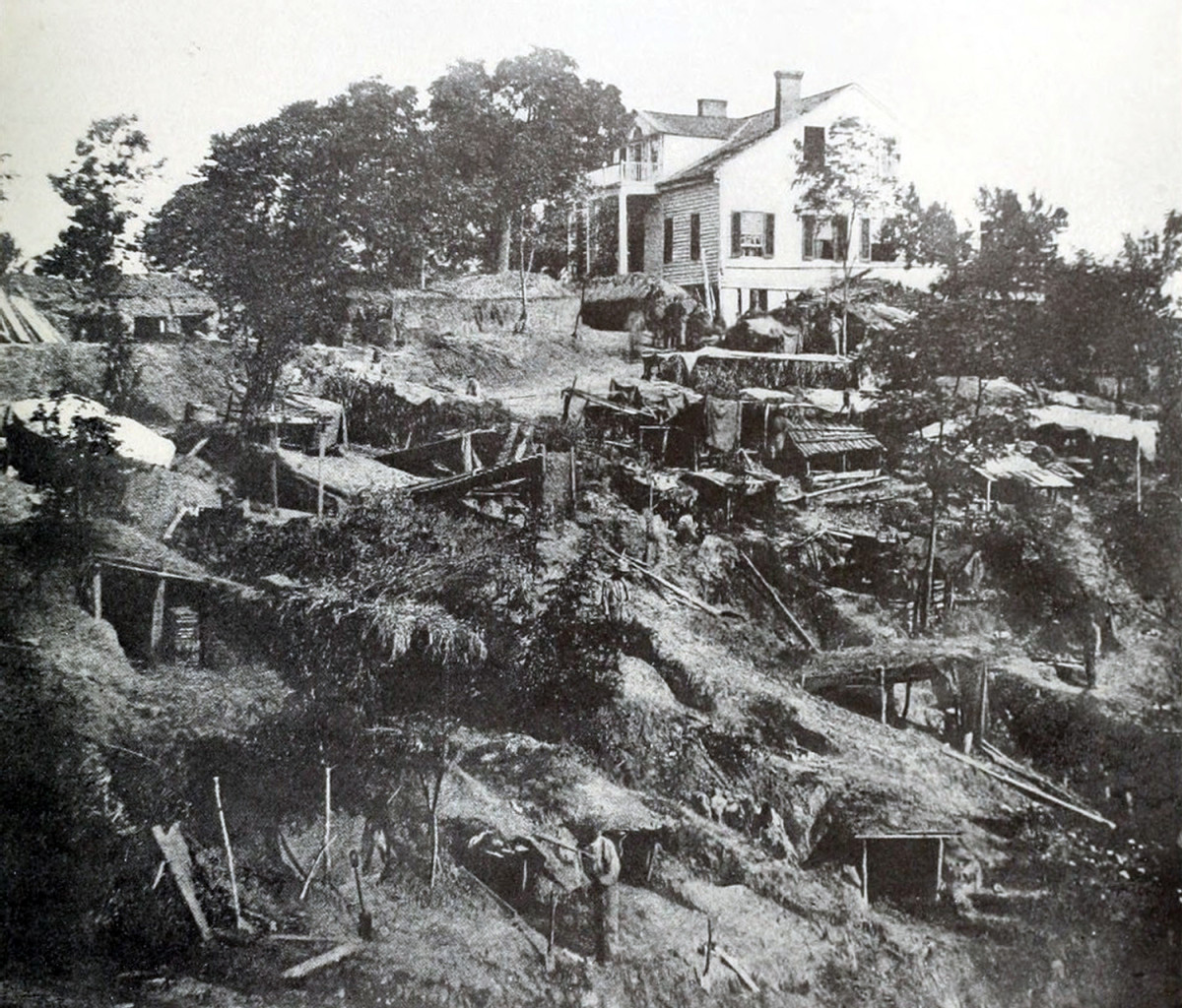 The Shirley family's home, shown during the siege, was inside Union lines at Vicksburg. Removed from the dangerously exposed house, family members found shelter in a cave.