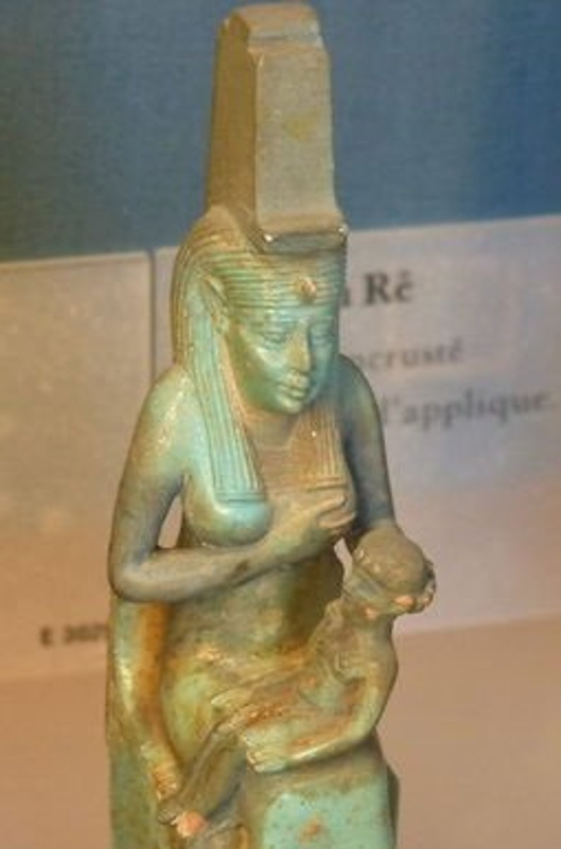 Isis is depicted with a throne on her head. In this figurine, she nurses Horus.