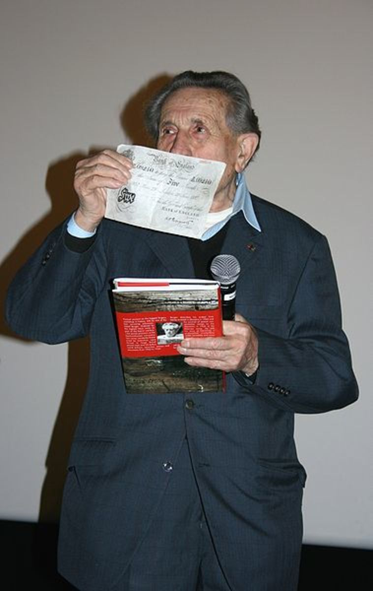 "Adolf Burger, at 2008 premiere of ""The Counterfeiters"", holding up one of the notes"