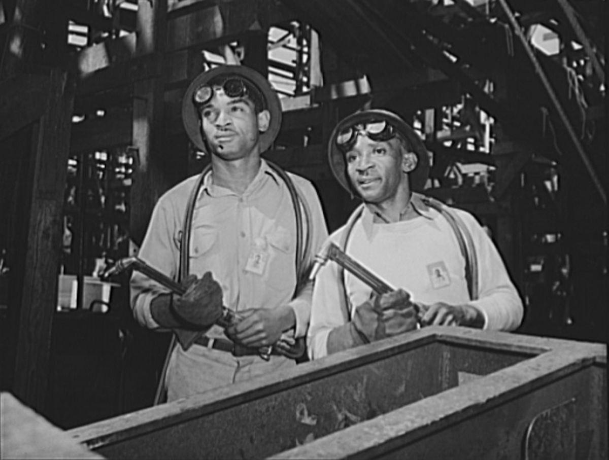 Proud workmen helping build the Booker T. Washington