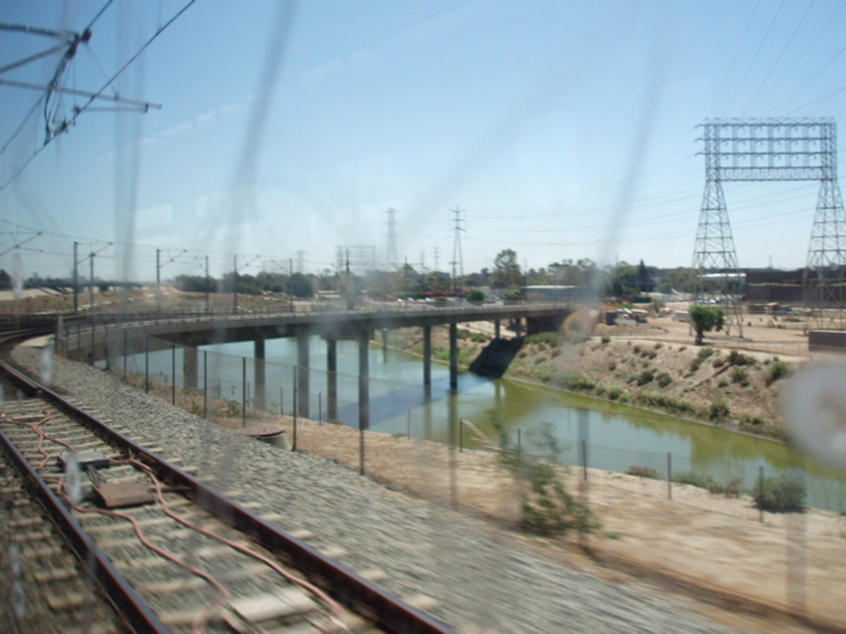Los Angeles River as seen through the window of a subway train. Note the difference from its original, natural state pictured above.