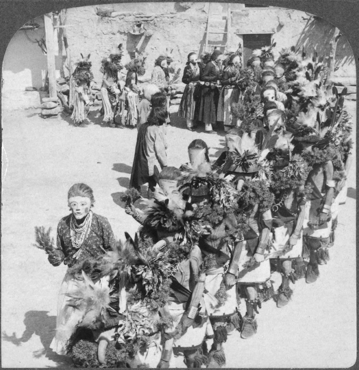 Kachina dancers of the Hopi pueblo of Shongopavi, Arizona, USA taken sometime between 1870 and 1900. Dancers of the Powamu Ceremony.
