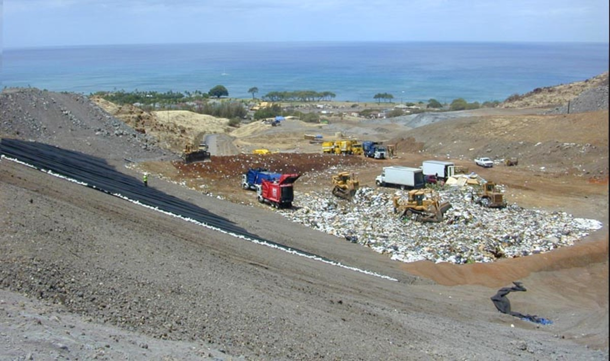Modern landfill operation at Waimanalo Gulch, the municipal sanitary landfill for the City & County of Honolulu.