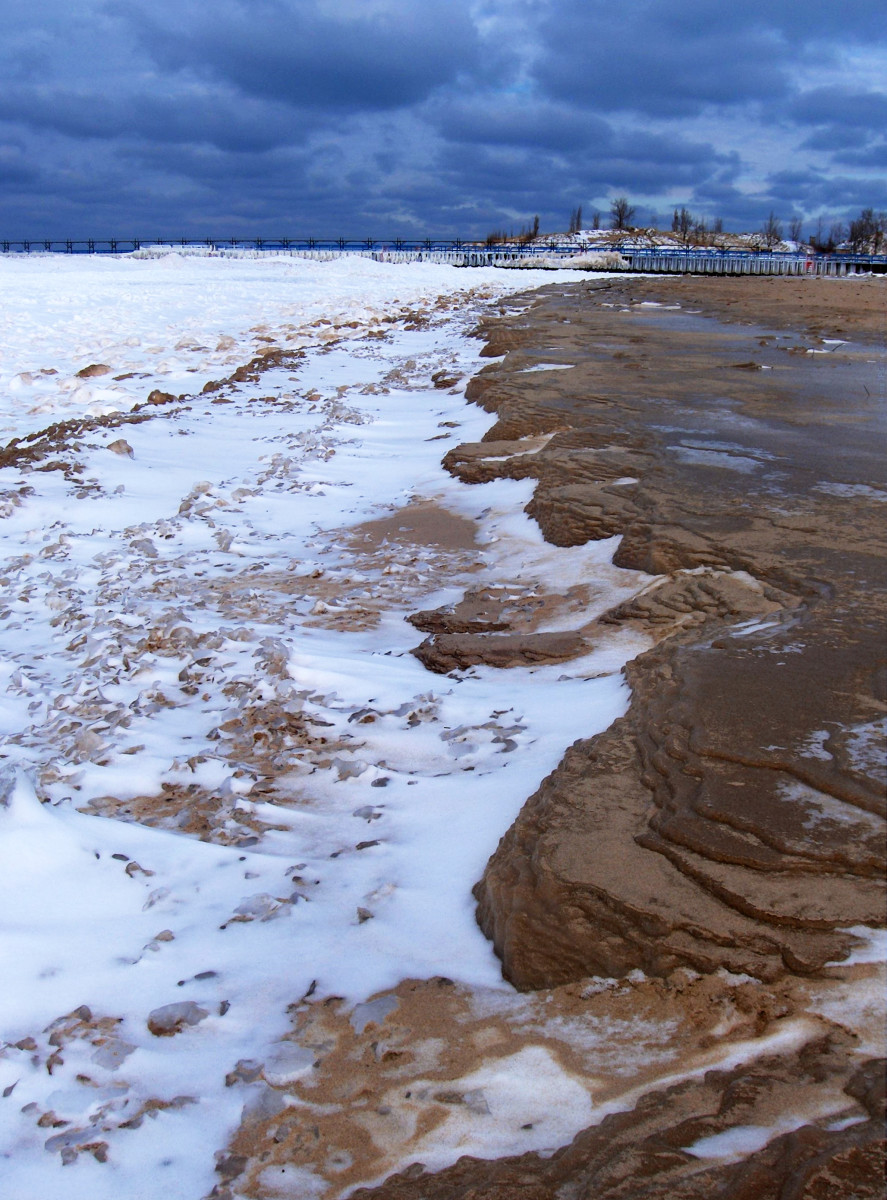 St. Joe, Michigan's Silver Beach shoreline with solidified ice chunks and frozen sand