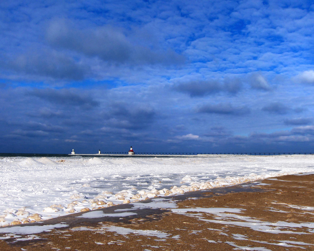 Frozen shoreline beginning to develop one week before the  Polar Vortex event on Lake Michigan and St. Joe lighthouse