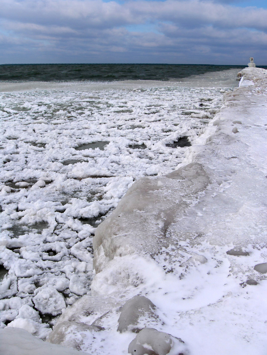 Ice chunks moving into shore at South Pier in St. Joe, Michigan near Silver Beach