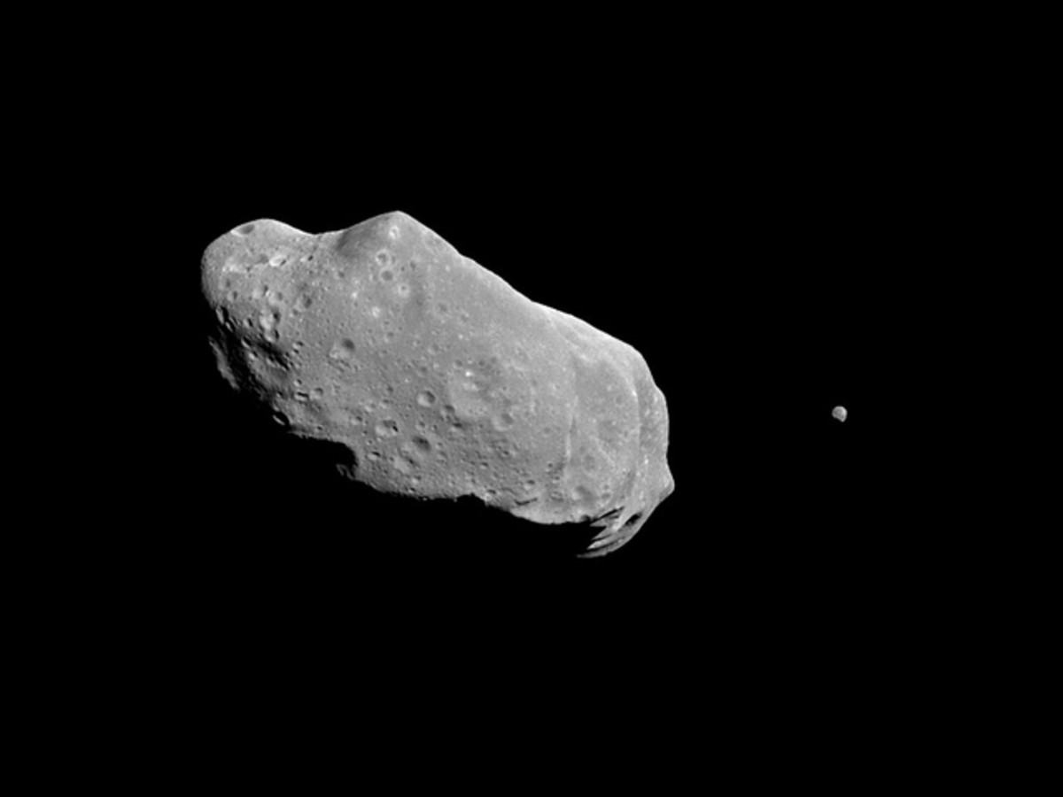 An asteroid is a mass of matter in space. This asteroid is the first known to have a satellite (the small object in the right of the photo.)