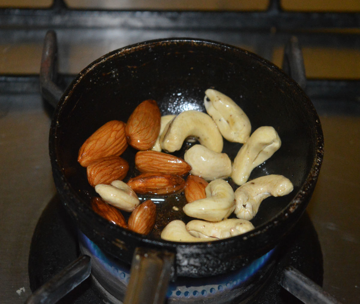Fry the cashew nuts and almonds in some ghee until they become crispy. Collect them on a plate.