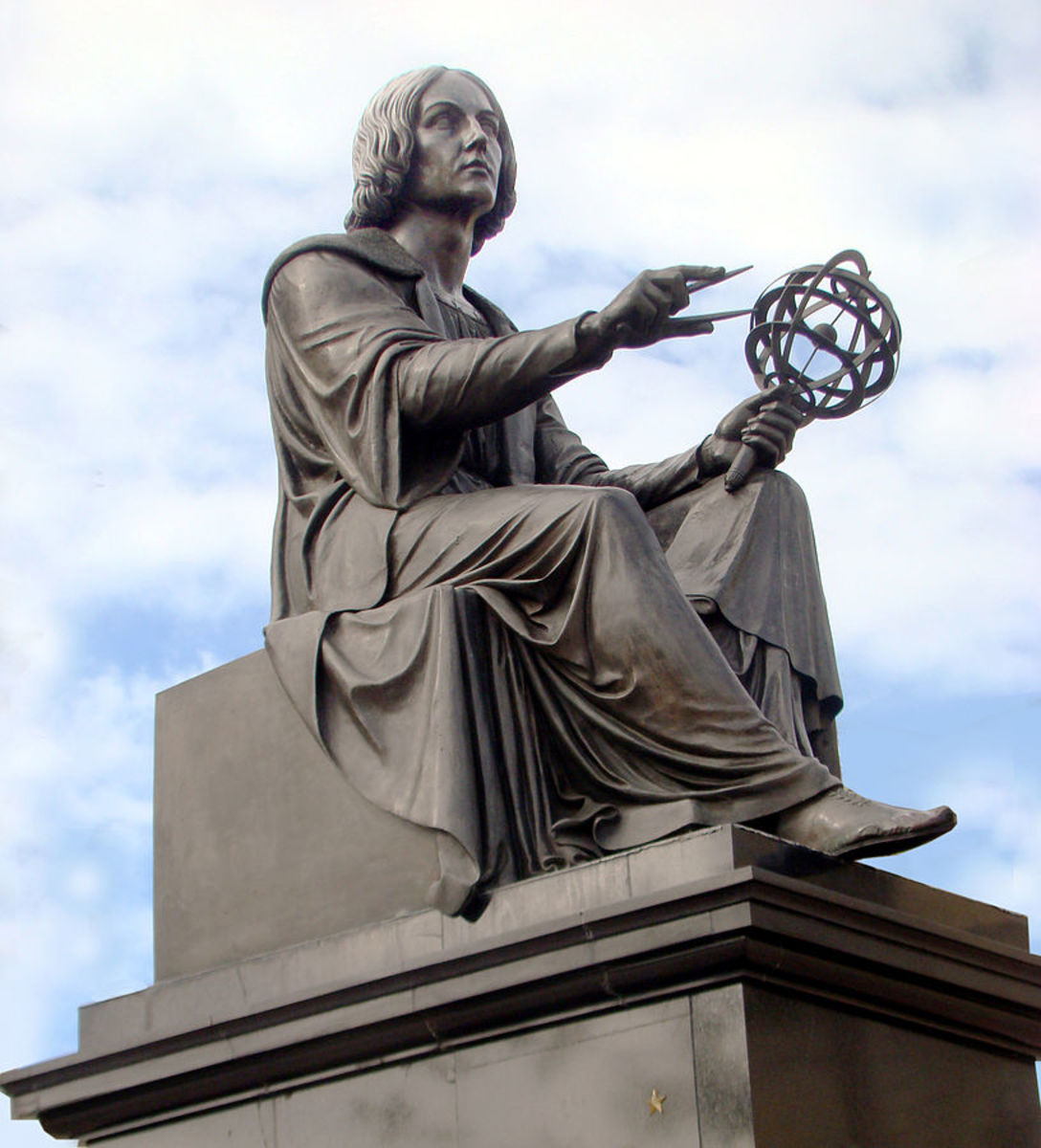 "Nicolaus Copernicus monument before the Polish Academy of Sciences in Warsaw. Copernicus holds a compass and armillary sphere. The inscription in Polish on the pedestal reades: ""To Mikołaj Kopernik [from his] compatriots"""