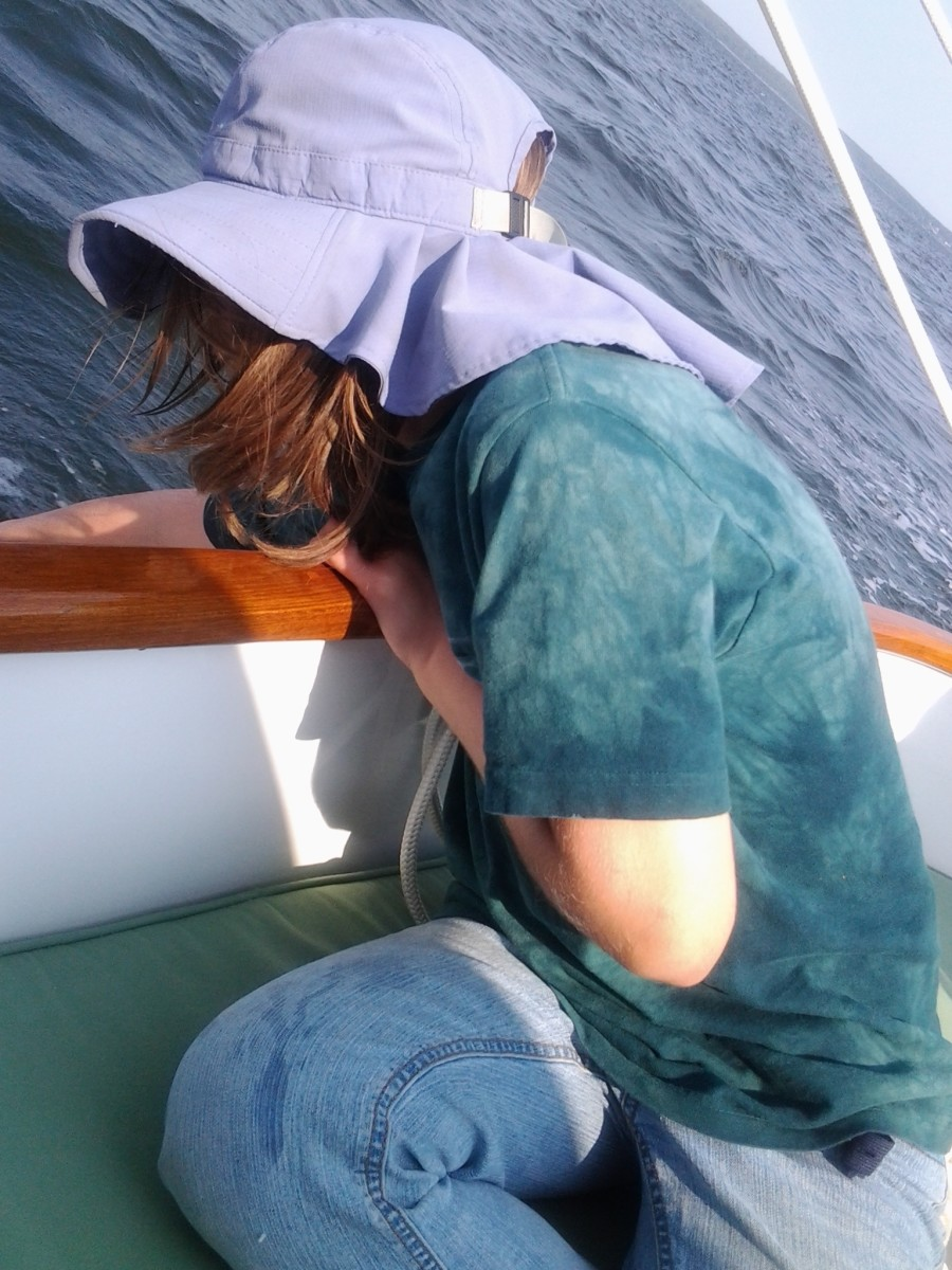 My daughter loves to touch the surface of the water when we are under sail in our neighbor's boat.