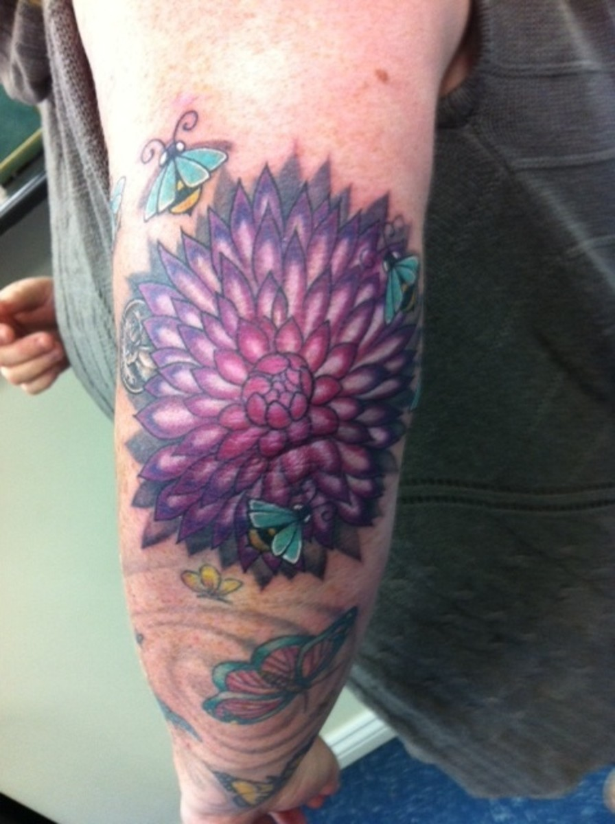 I did it, I did it! 5 bees, a flower and a whole lot of pain to commemorate my 40th.