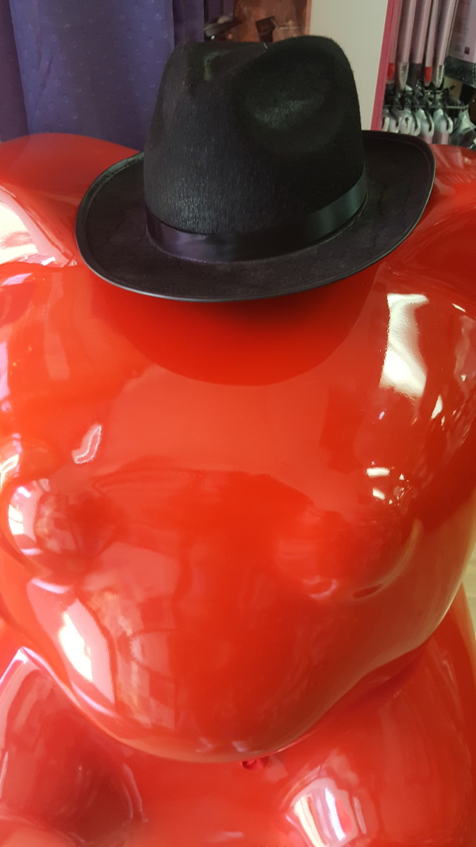 The suave red gummy bear who guards the entrance at Pure Delish.
