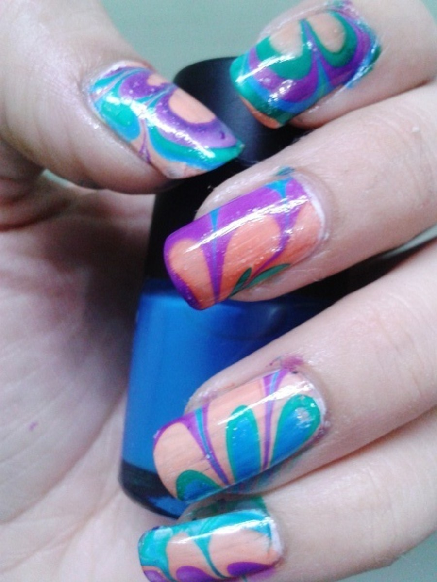 Water marble nail art using four bright color nail polishes