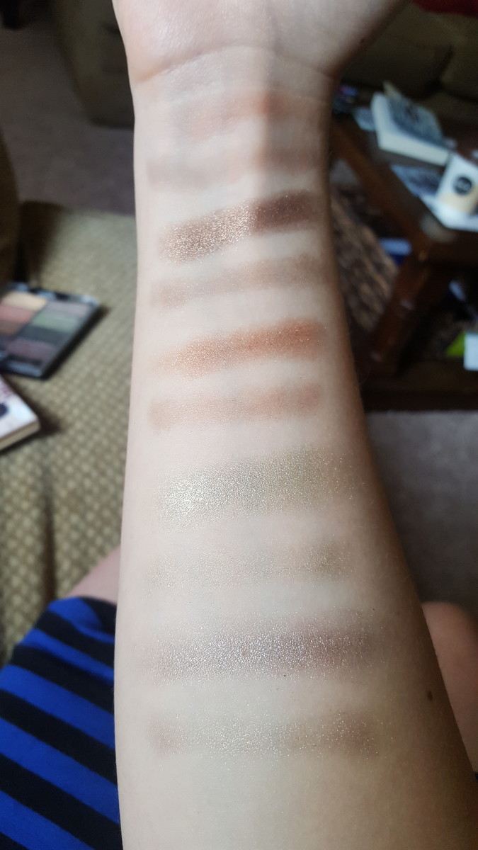Finger and brush swatches from the right side of the palette (mostly browns and greens). From top to bottom: Myth, Magic, Wings, Marvel, and Trance.