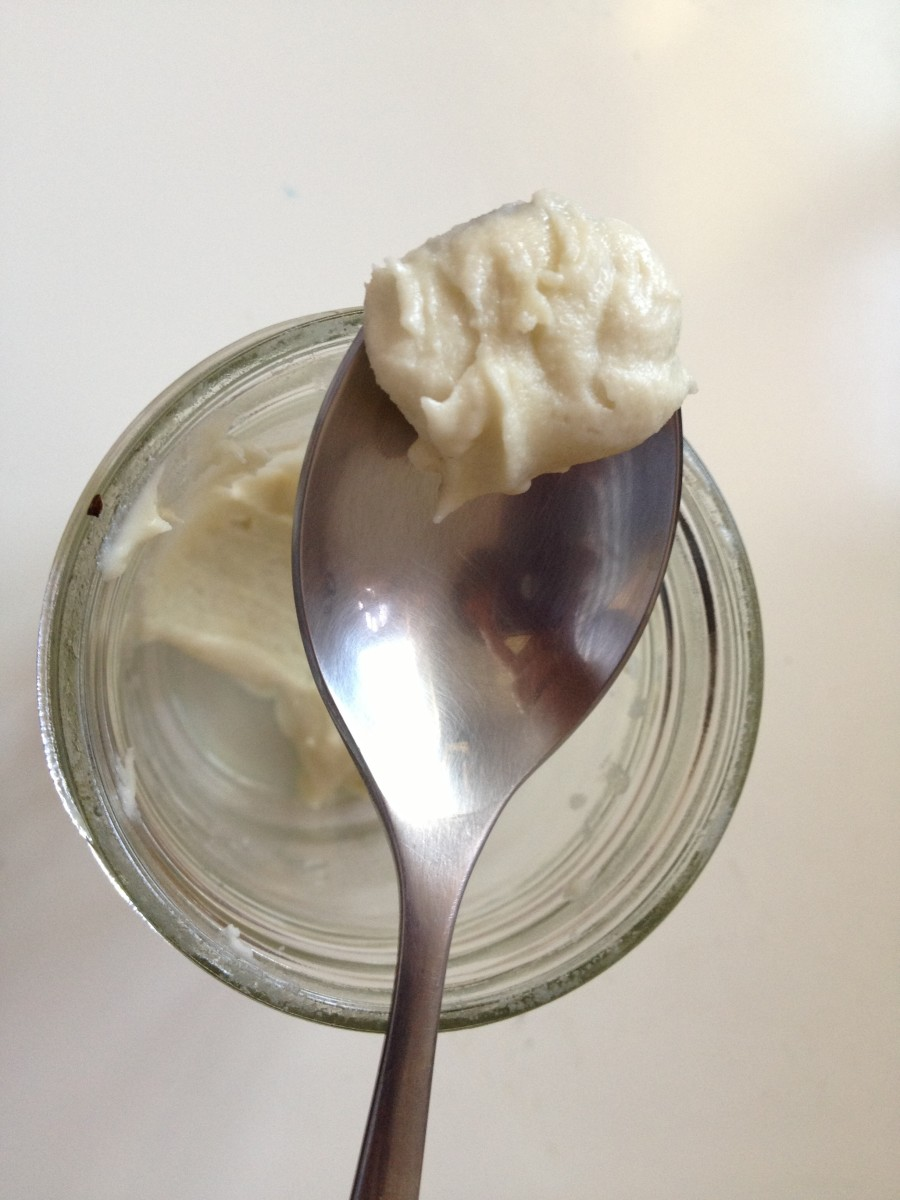 Homemade moisturizer with shea butter, coconut oil, and tea tree oil.