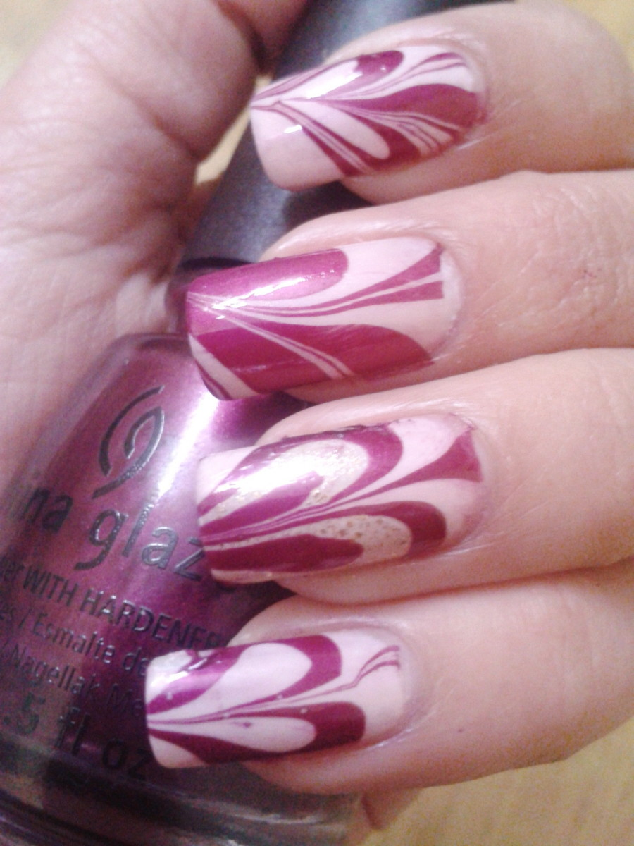 Heart nail art with water marble nail art technique