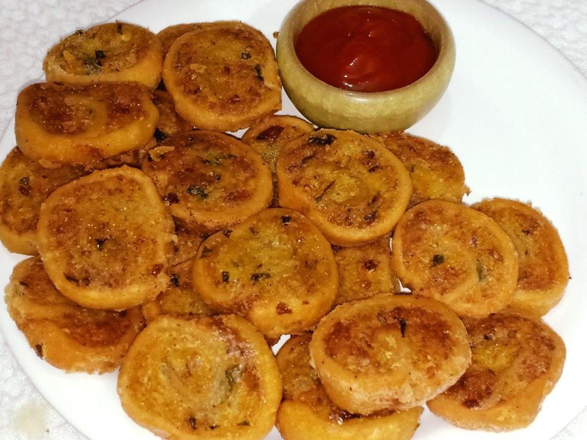 Indian-style potato pinwheels served with tomato sauce