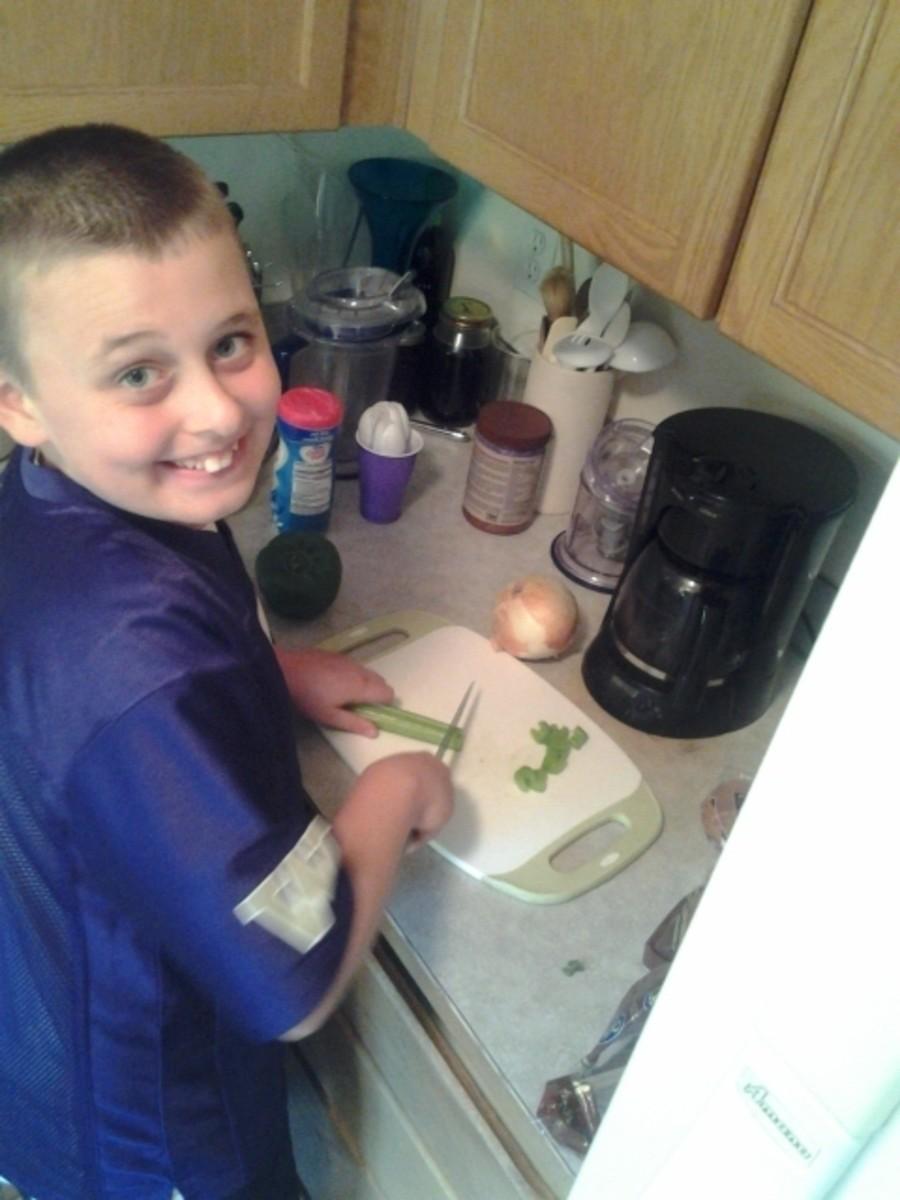 Boy Chopping Celery