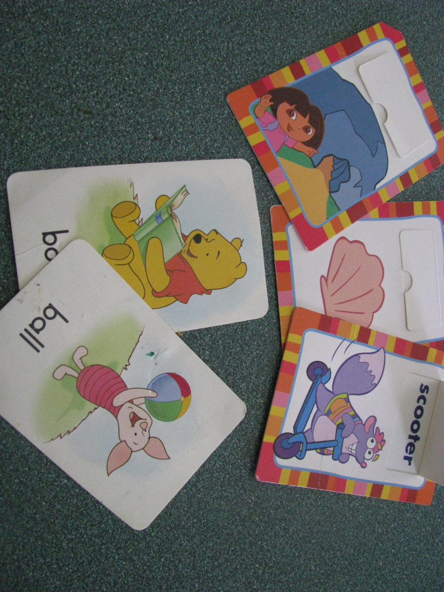 Flash cards with simple words are great for vocabulary development.
