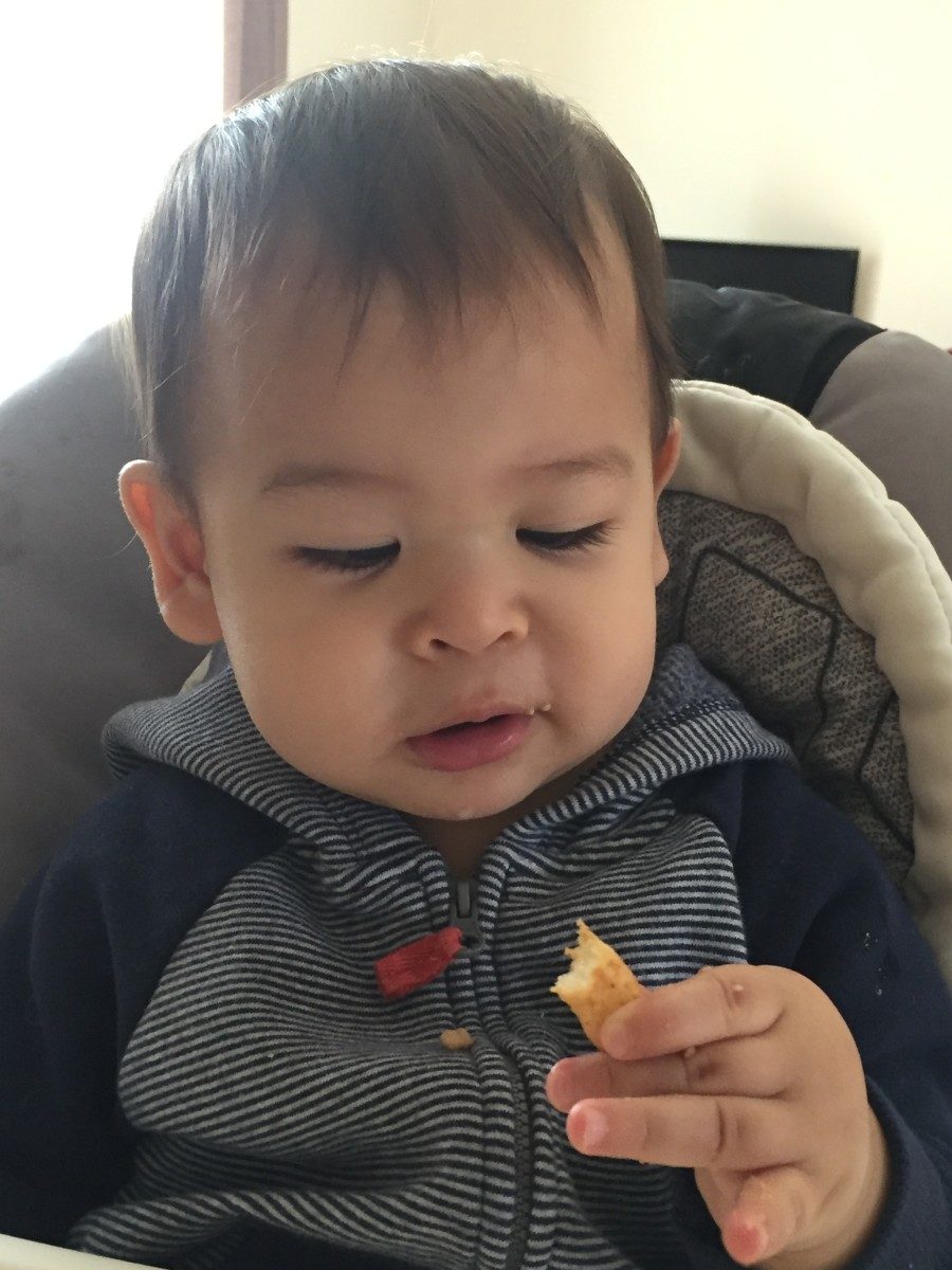 Babies love to eat peanut butter puffs. It is easy for them to hold the puffs, and it can help them improve their fine motor skills.