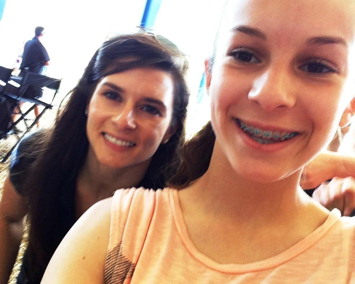 Auto racing driver Danica Patrick poses with my daughter for a selfie. But wait a minute -- what about a selfie with your mother?