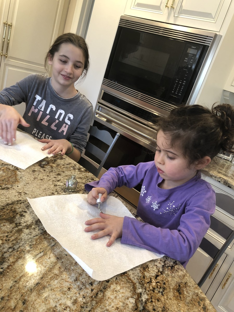 Here Em is painting her nails  with her cousin at their  Grandma's house. What better way to have fun with family than doing your nails together?