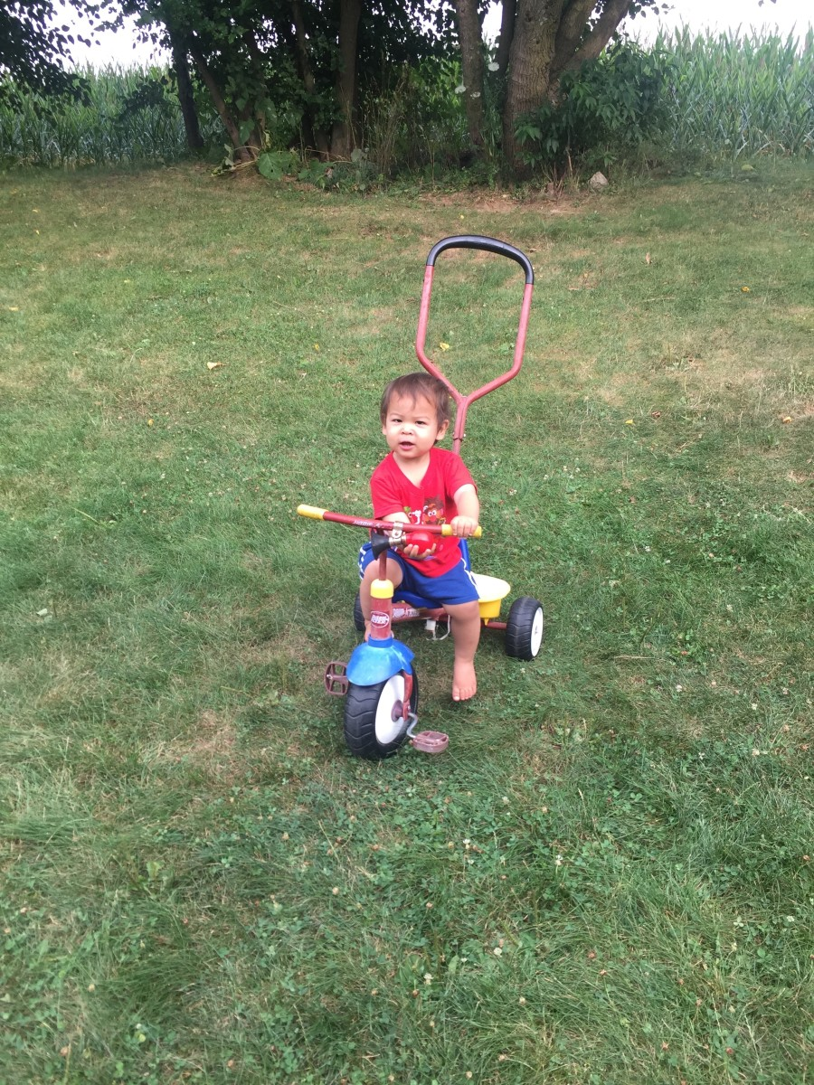 My toddler loves to ride on his tricycle!