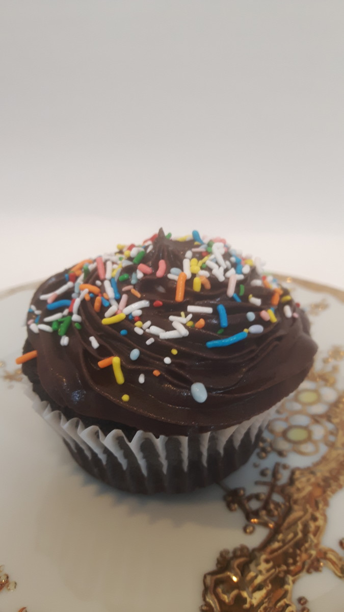 Sprinkles on a plastic bag chocolate cupcake