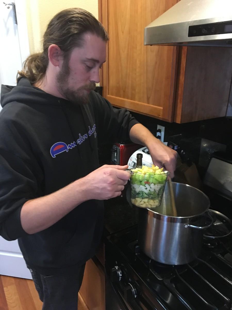 Adding more veggies.