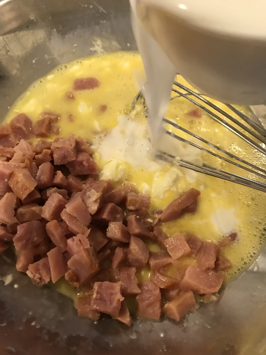 Stir in the diced ham (perfect for leftover ham), salt, pepper and milk.