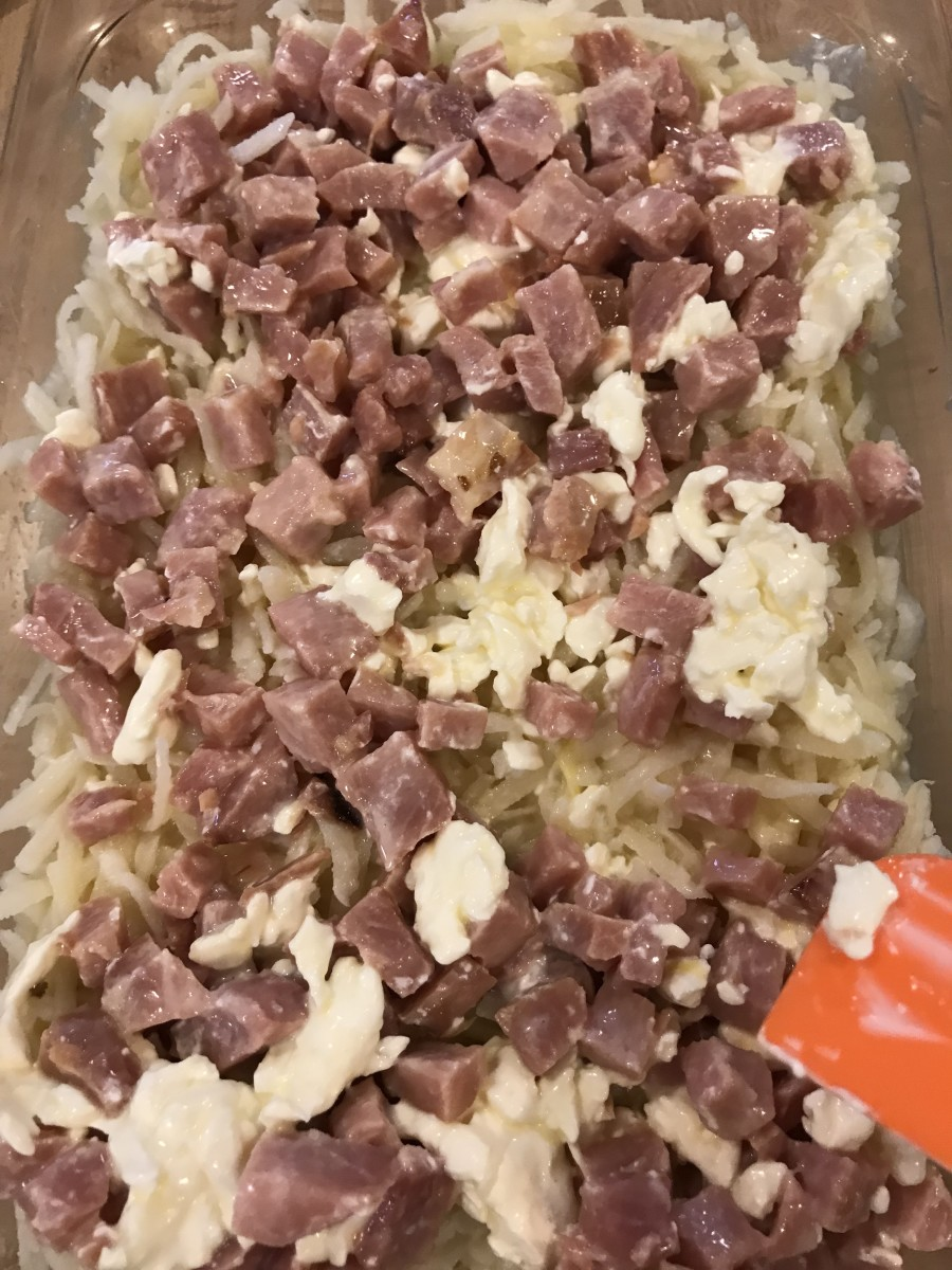 Pour mixture into the buttered casserole dish. If needed, redistribute the ham a bit to make it even.