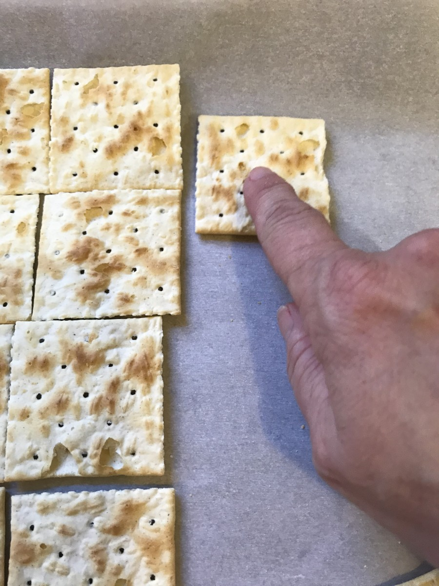 On a parchment lined baking sheet, lay out the saltine crackers. Keep them touching but not overlapping—although in all honesty, they'll wiggle out of place when you pour on the toffee and then bake. No problem. This is easy stuff.