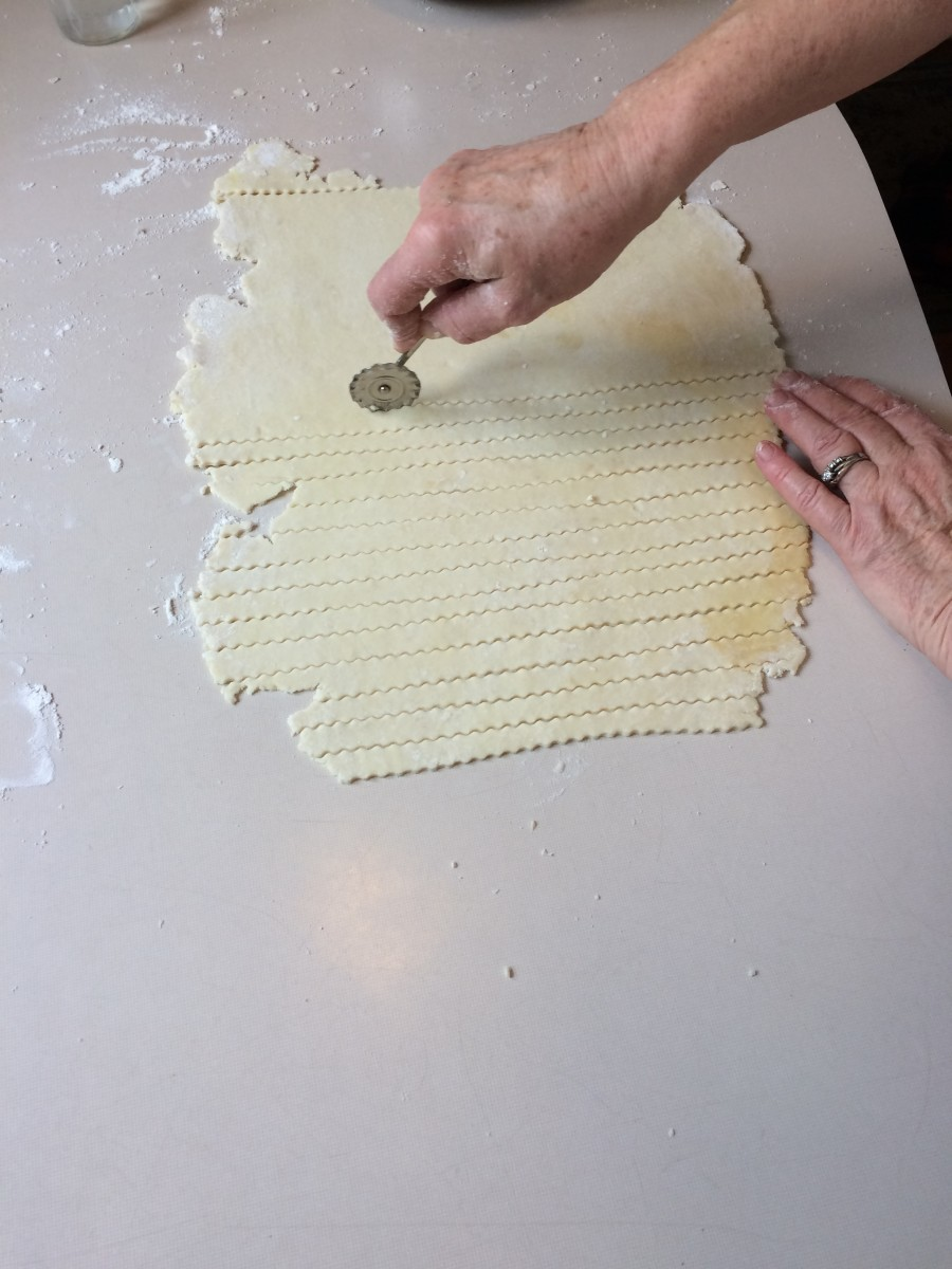Continue across the rolled-out dough using a careful roll with the pie crust roller.