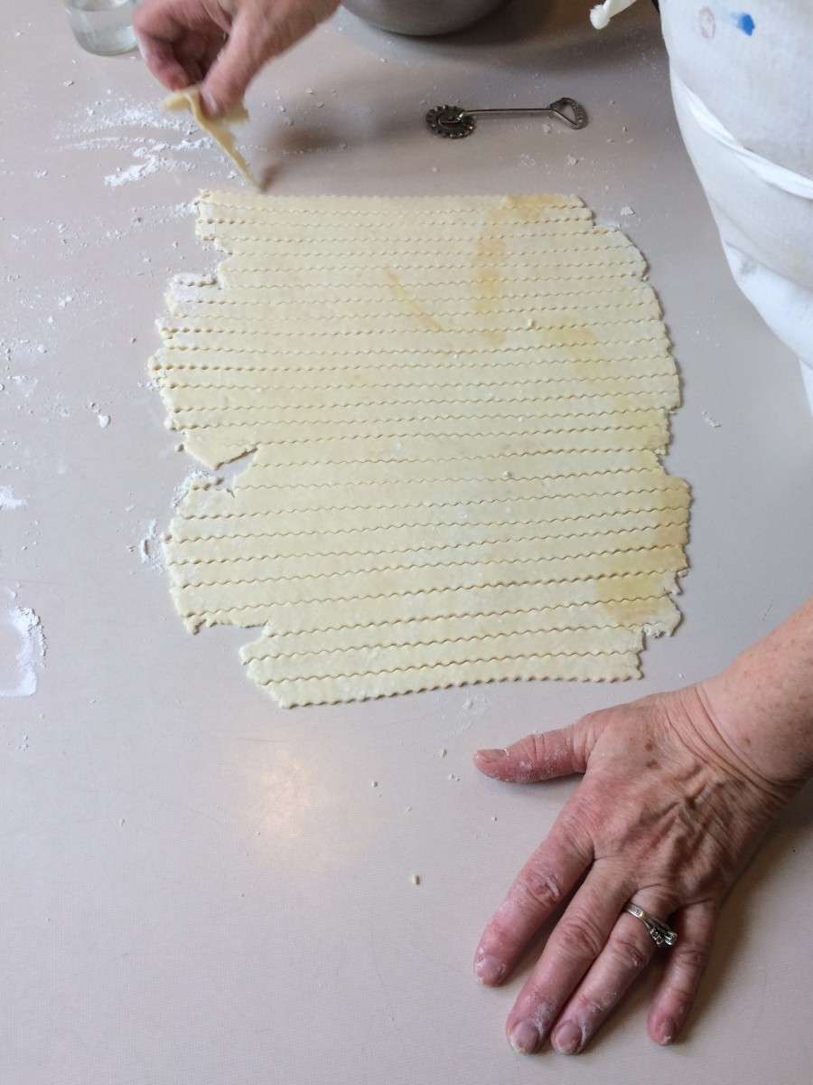 Once you have cut the whole piece of dough, you are ready to put the pie filling into the bottom crust and begin the lattice work.