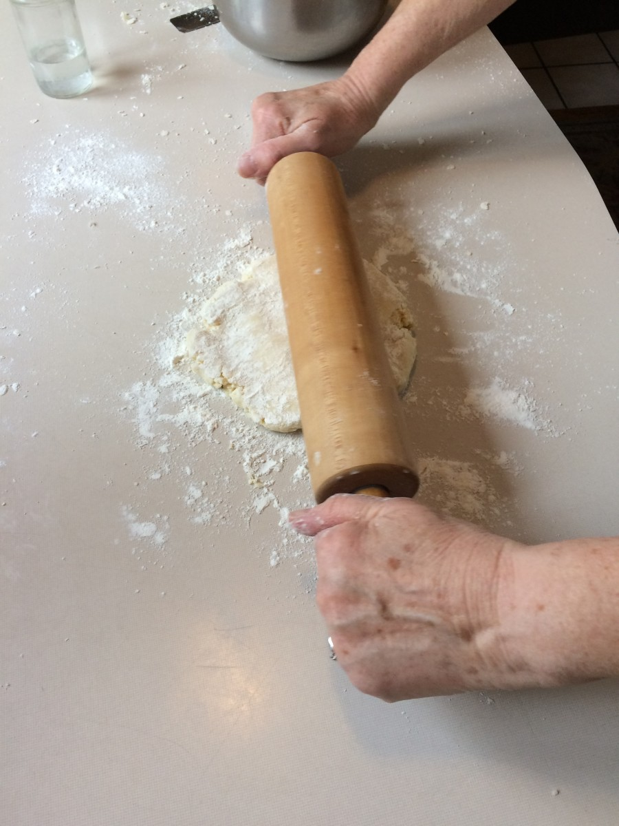 Using gentle pressure begin rolling out the dough.