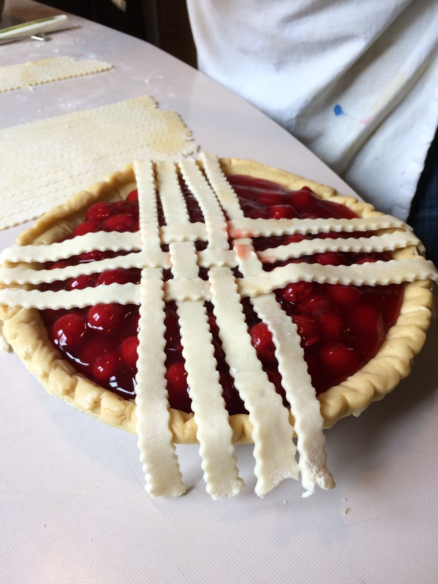 Now you see how this is going. I work from the center out, adding strips on each side until the pie is fully latticed.