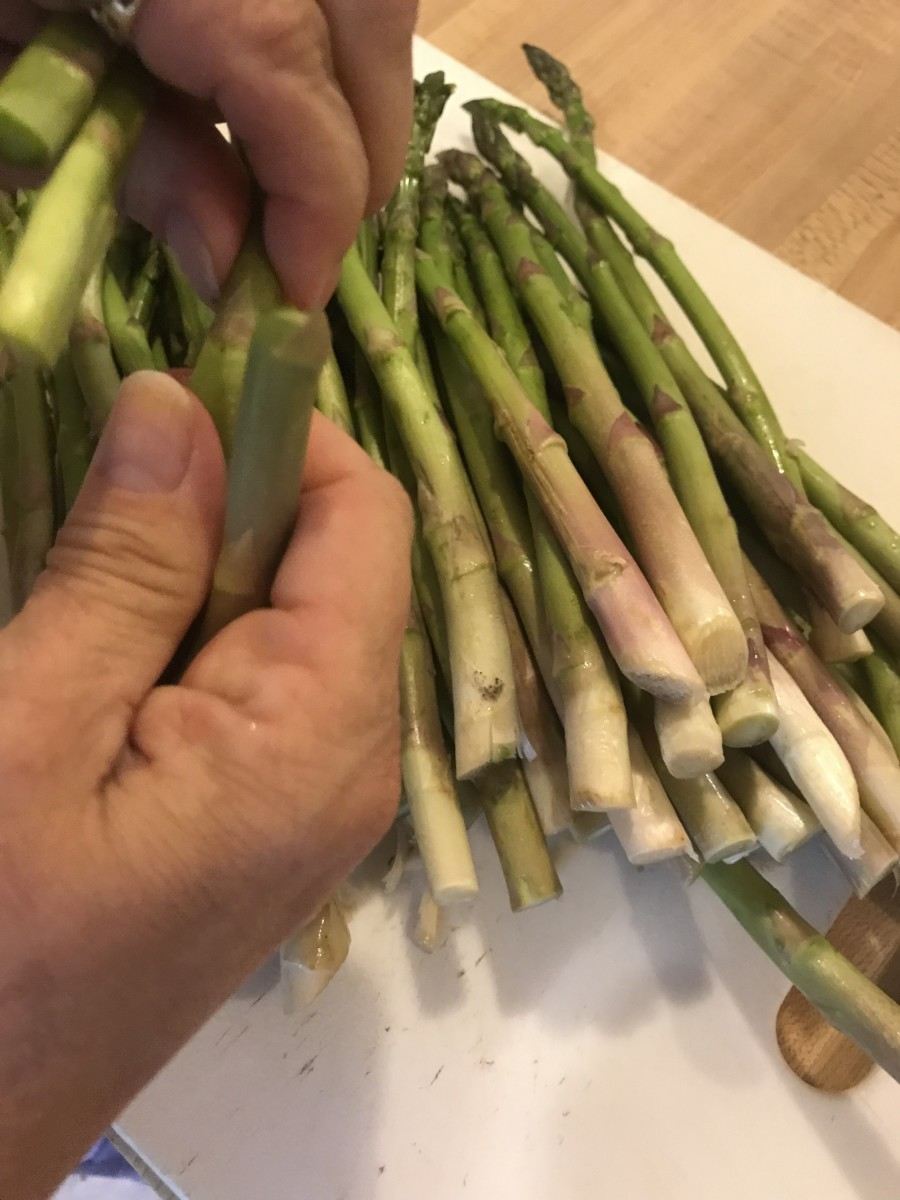 Prepping asparagus is a snap - literally! Hold the spear close to the root end and bend - it will break at the right spot - about an inch or so up. You can also trim them with a knife if you'd like.