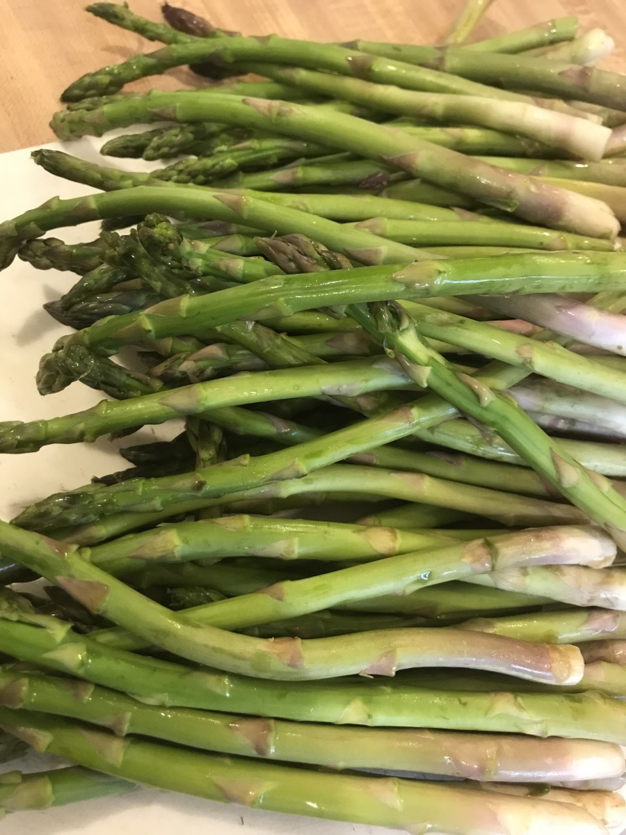 I like smaller, more tender asparagus. Look for pencil sized spears, and simply rinse them off before snapping off the ends.