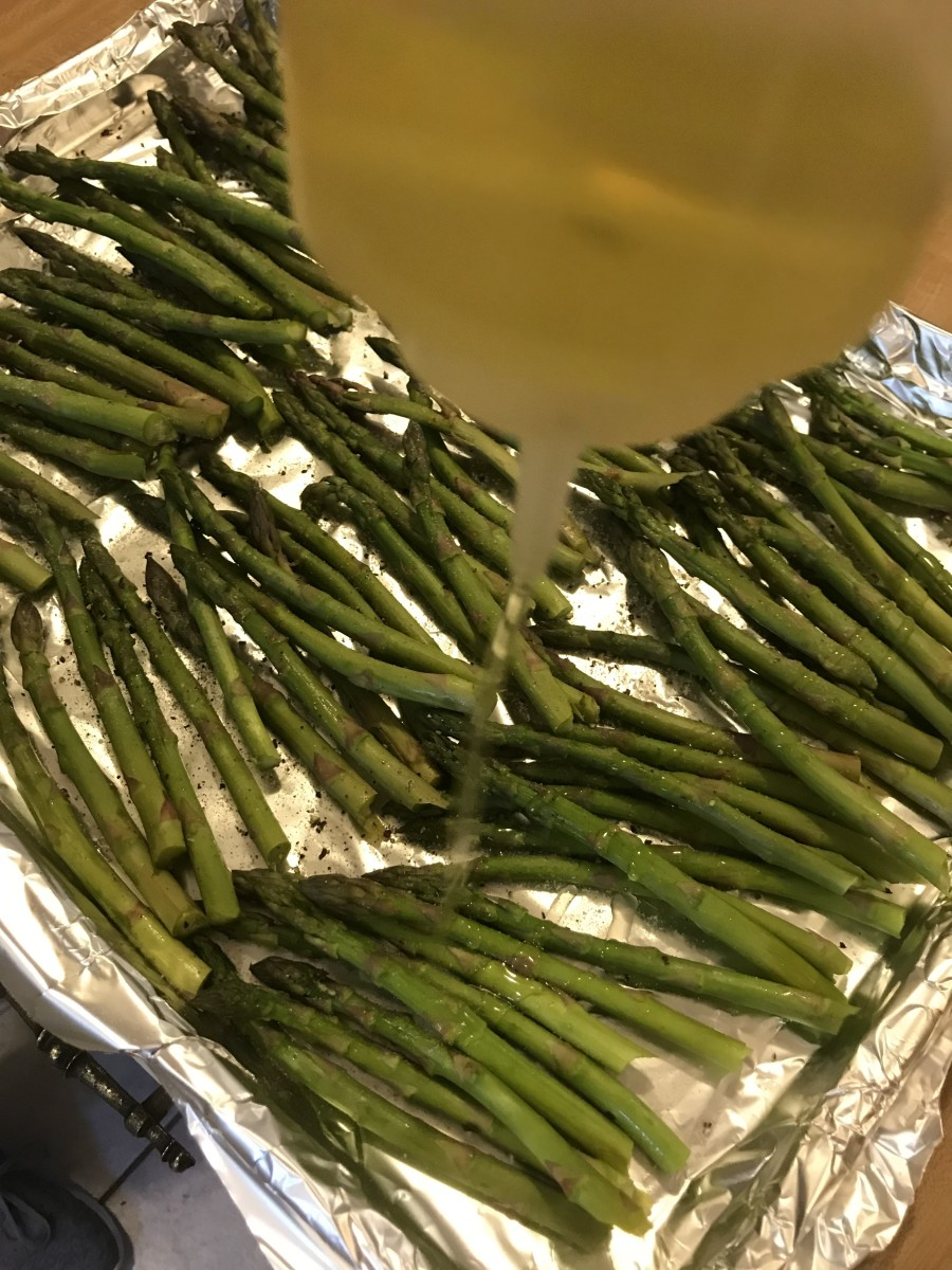 Lay the asparagus in a single layer on the baking sheet and drizzle with a little olive oil. It only needs a couple of teaspoons- too much and the finished asparagus will be greasy and oily. Just a little is all you need.