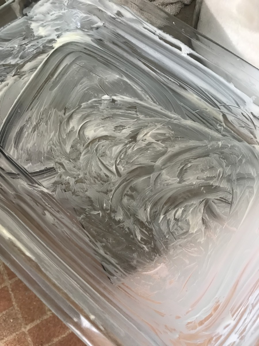 Start by generously buttering a 9x13 casserole dish. This adds another layer of flavor to the finished dish, and helps with easy cleanup by keeping the dish from sticking.