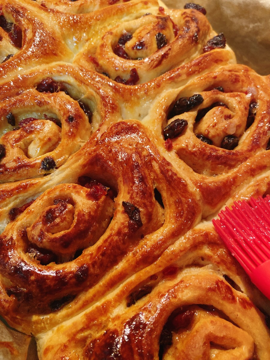 Brush the warm cinnamon rolls with honey or apricot jam or sugar syrup and let them stand until set.