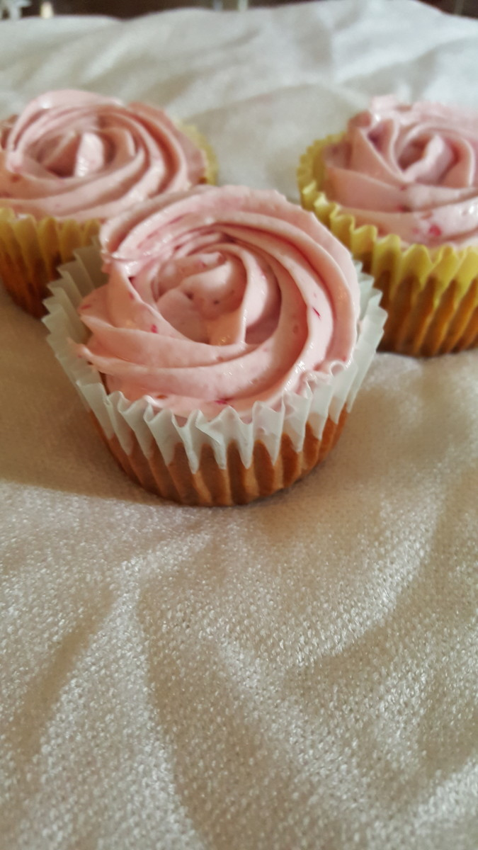 Tart lemon juxtaposed sweet raspberries give this cupcake bold flavors. Topped with a raspberry cream cheese frosting, this was the favorite cupcake of taste testers.