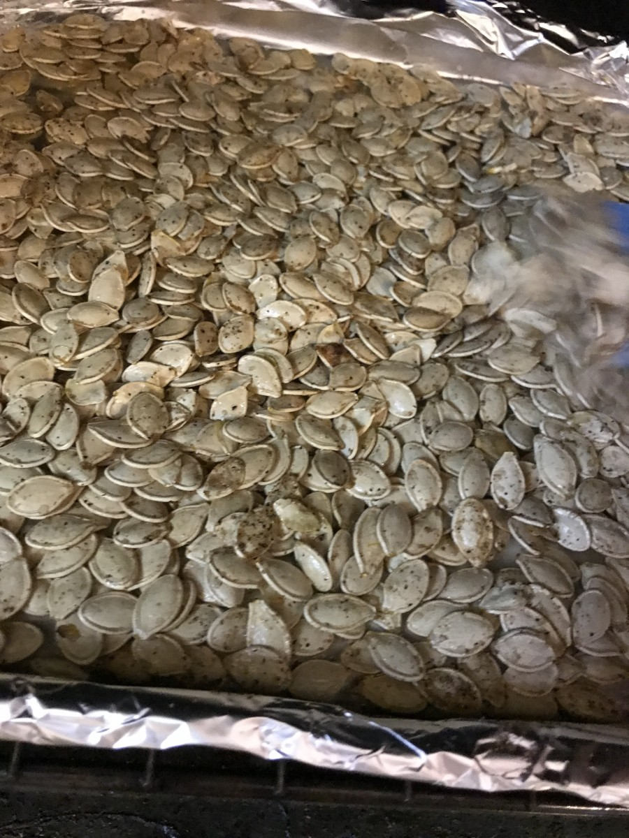 About half an hour should do it - you're looking for bits of the seasonings to get very dark golden - but not black! At the end, keep a close eye on the pumpkin seeds. Golden is wonderful - but burnt is burnt.