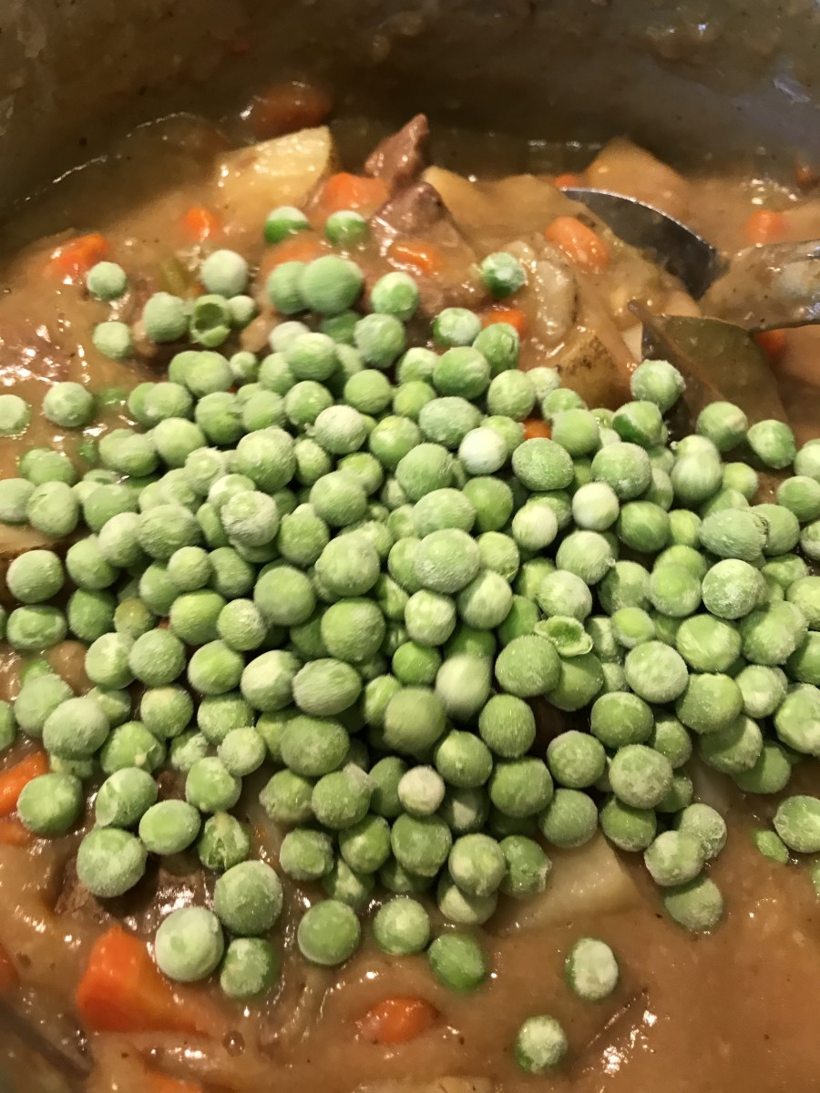 I wait until the last minute to add peas - you can use fresh or frozen. I always have frozen peas. I really only let the stew warm the peas through. They stay nice and crisp, giving a beautiful contrast to the richness of the beef and sauce.