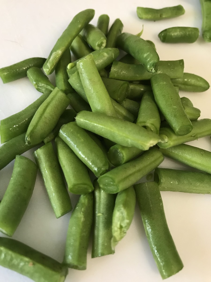Add cut green beans right as you add the pasta. They'll cook in the broth, but not over cook, since the pasta takes only ten minutes. This leaves them crisp tender and perfect in the finished soup.