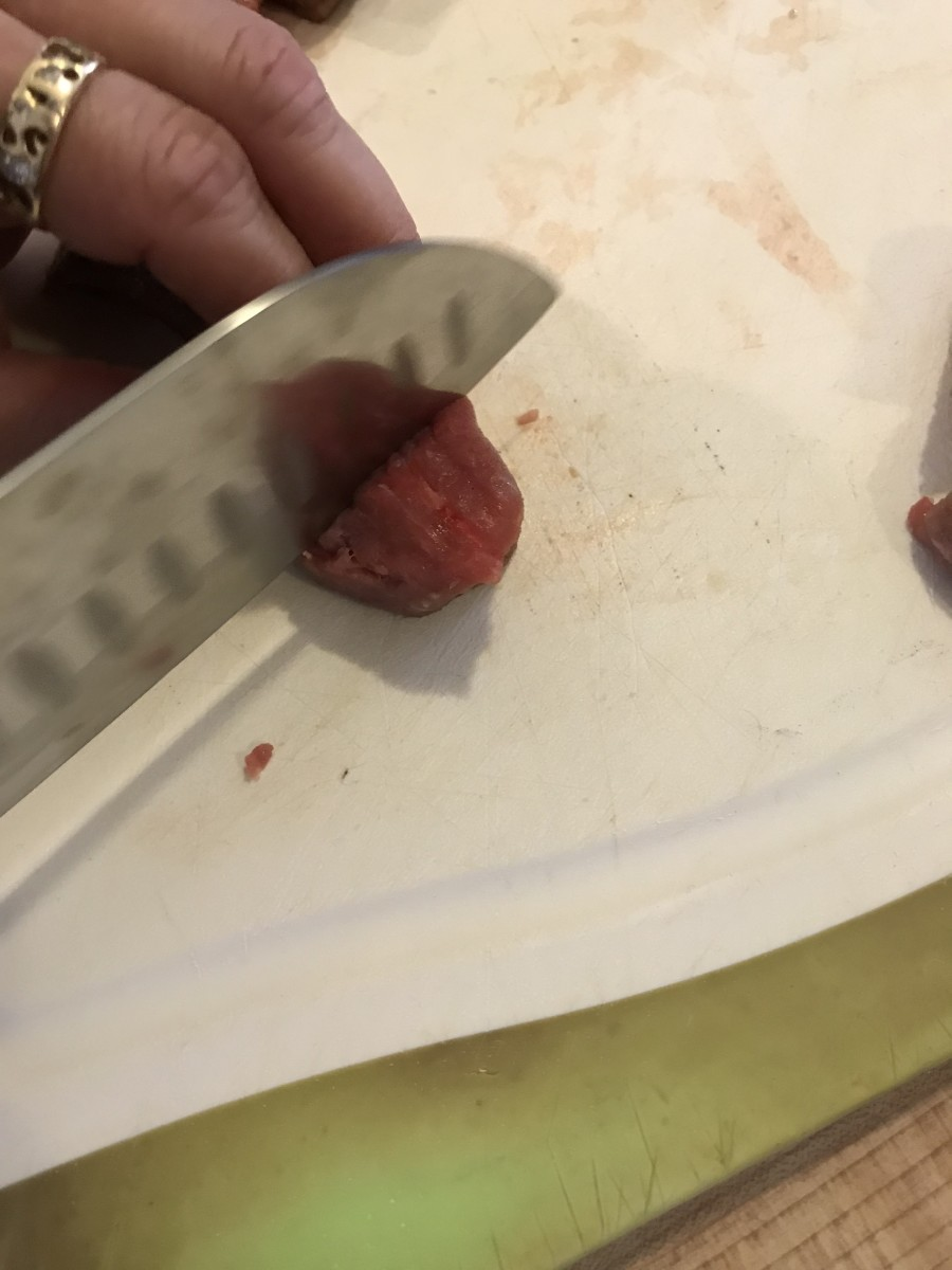 Whole beef chuck is usually less expensive than buying precut stew beef, but not always, so check the per pound price. I like smaller bites, so I cut it into 1 or even 1/2 inch cubes before seasoning and flouring.