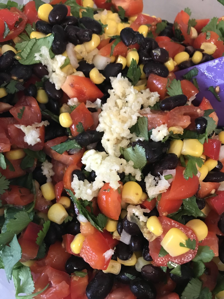 Kosher salt, black pepper and fresh garlic are the perfect seasonings for the sweetness of the corn, tomatoes and peppers. Season to taste, and remember, cold foods need a bit more seasoning than hot foods.
