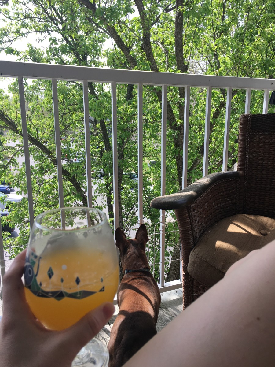 Enjoying the fresh air on my deck with a homemade orange crush.